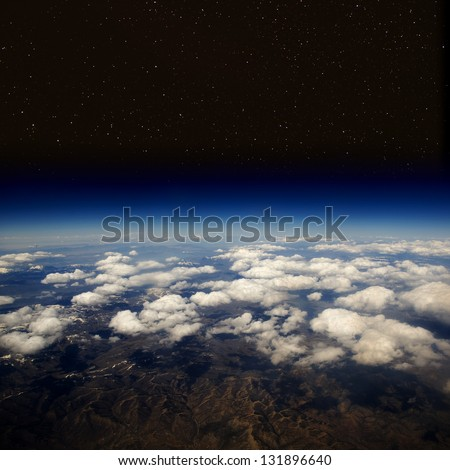 High altitude view of the Earth in space with stars. The desert in the western United States. - stock photo