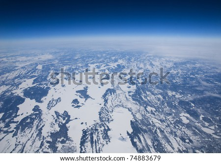 High altitude view of the frozen tundra in Arctic Canada.. - stock photo