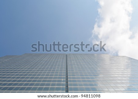 high angle building facade with cloud reflection