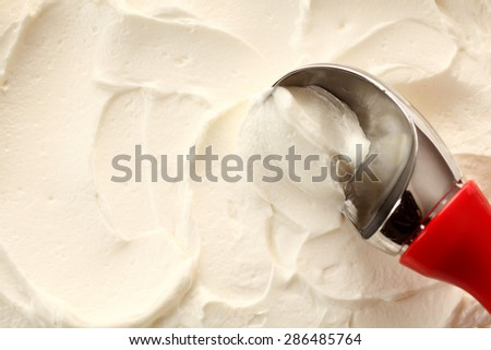 High Angle Close Up View of Red Handled Scoop Serving White Vanilla Ice Cream - stock photo