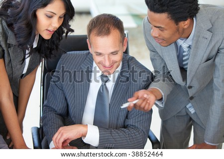 High angle of a manager with employees working in office - stock photo