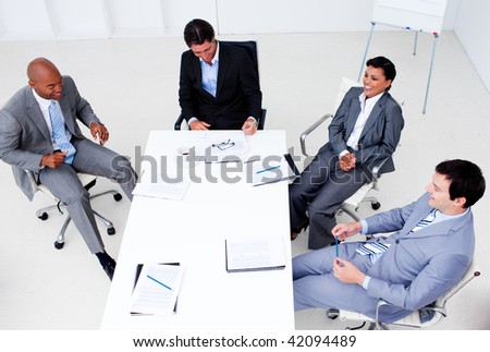 High angle of a smiling business team in a meeting. Business concept.