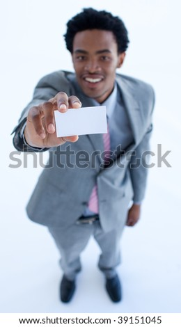 High angle of African businessman showing a small business card - stock photo