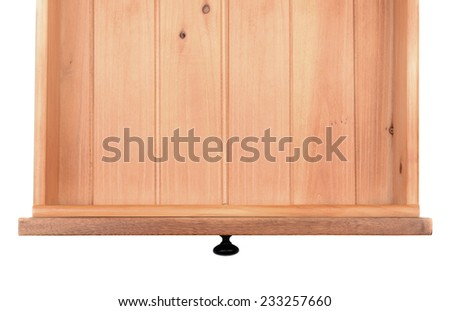 High angle of an empty kitchen or dresser drawer.  The wooden drawer is isolated on a white background and has a black metal knob. - stock photo