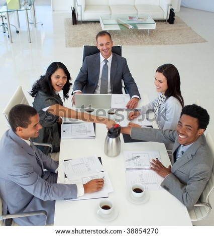 High angle of business people shaking hands in a meeting - stock photo