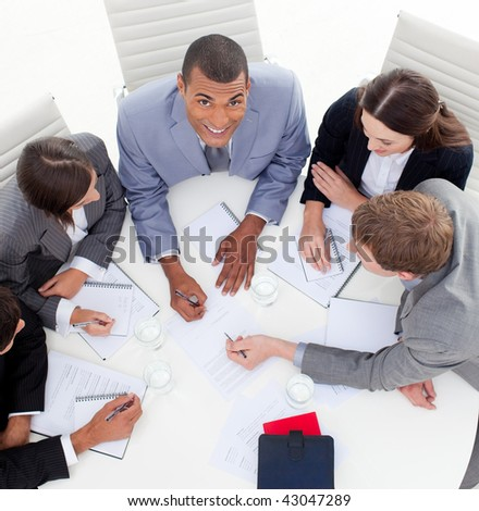 High angle of business people studying a new budget plan in a meeting