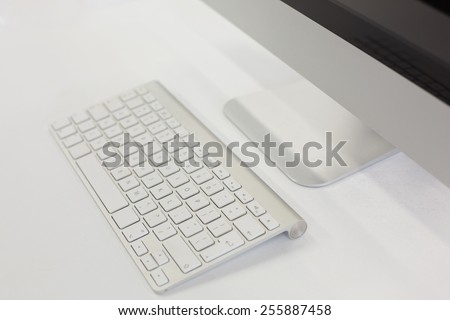High angle of keyboard and screen in computer room