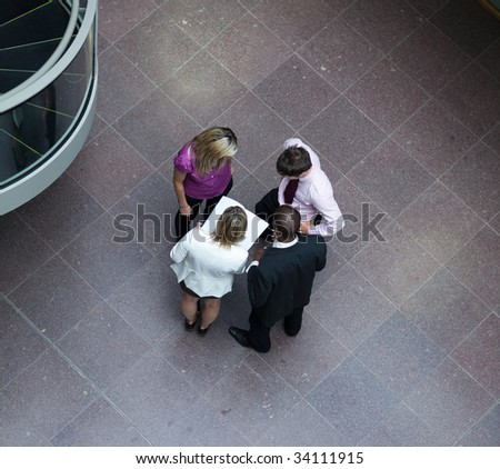 High angle of multi-ethnic businessteam interacting with each other - stock photo