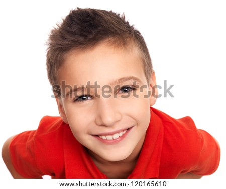 High angle portrait of adorable young happy boy looking at camera - stock photo