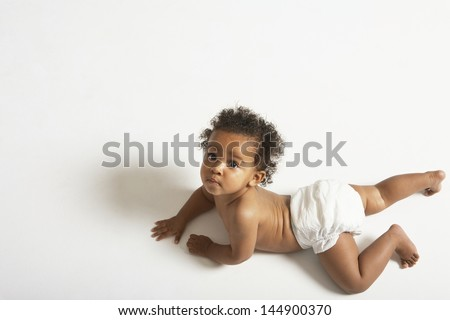 High angle portrait of cute baby crawling on white background - stock photo