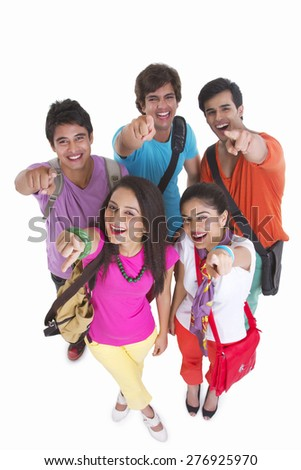 High angle portrait of university friends pointing at you over white background