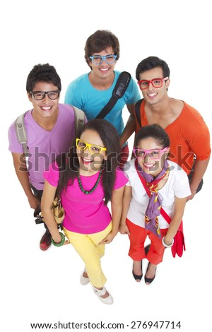 High angle portrait of university friends wearing colorful glasses on white background