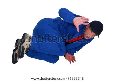 High-angle shot of a petrified tradesman - stock photo
