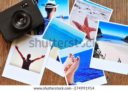 high-angle shot of a retro camera and some photos, shot by myself, of a young man at the beach and some of other beach scenes, placed on a rustic wooden table - stock photo