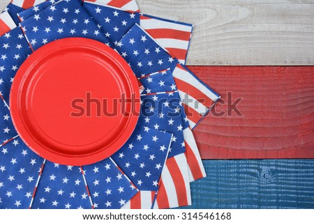 High angle shot of American Flag napkins on a red, white and blue picnic table. Horizontal format with copy space. Suitable for American Holidays: 4th of July and Memorial Day, and Veterans Day. - stock photo