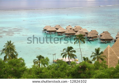 High angle shot of an Over water bungalows at a Moorea resort. Island Moorea. French Polynesia - stock photo