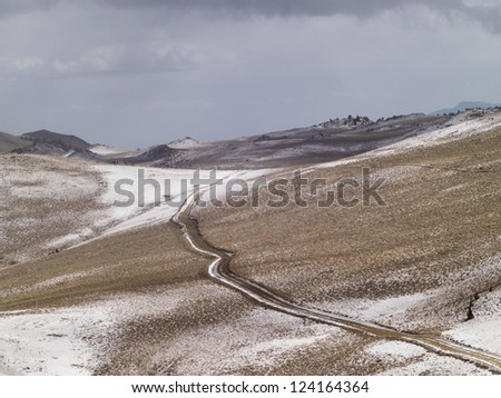 High angle shot of roadway on a mountain slope. - stock photo