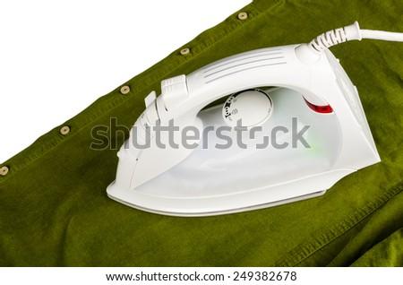 High angle take of an iron on a corduroy shirt - stock photo