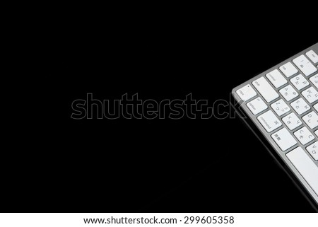 High Angle View Close-up Of Multilingual  Wireless Keyboard Isolated On Black Background With Copy Space. English, Chinese And Russian Letters Ans Symbols