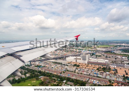 high angle view from window of bangkok city of thailand on the air plane - stock photo