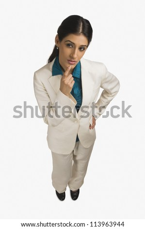 High angle view of a businesswoman thinking - stock photo