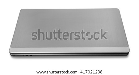 high angle view of a closed metallic notebook in white back