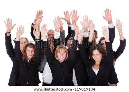 High angle view of a diverse group of business people waving in acknowledgment of an accolade isolated on white - stock photo