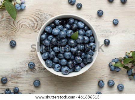 High angle view of a freshly picked blueberries on the old wooden desk