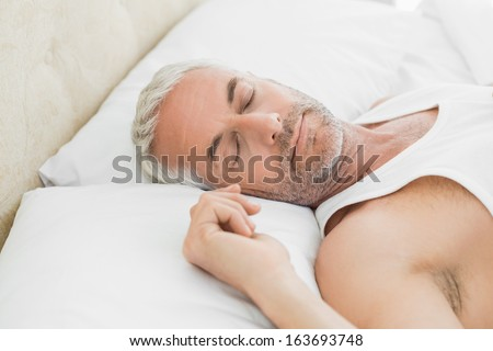 High angle view of a mature man sleeping in bed at home