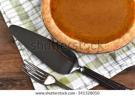 high angle view of a pumpkin pie server and fork the dessert is part - Pie Server