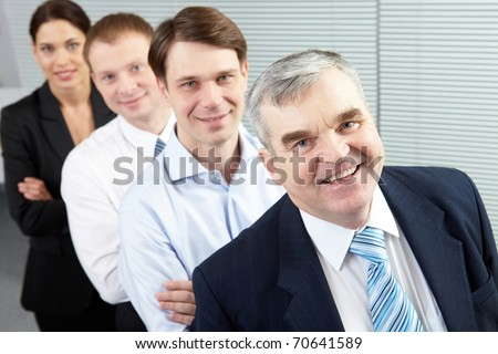 High angle view of a senior chief and his team - stock photo