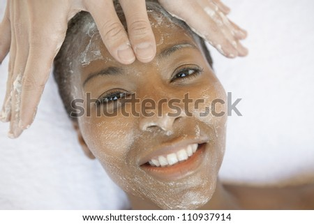 High angle view of a woman receiving facial treatment - stock photo