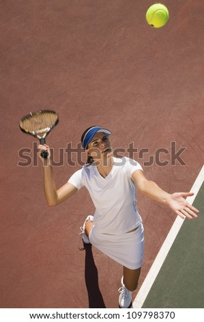 High angle view of a young woman playing tennis - stock photo