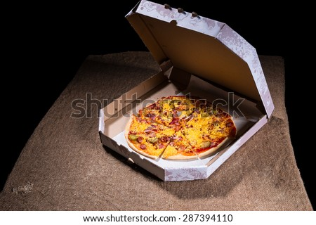 High Angle View of Artisan Pizza Topped with Variety of Toppings and Cheese in Carboard Take Out Box with Open Lid on Table Surface with Copy Space - stock photo