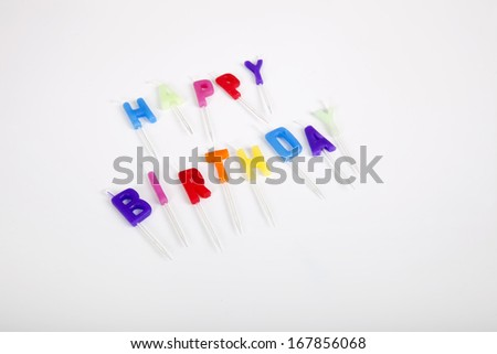 High angle view of birthday candles against white background - stock photo