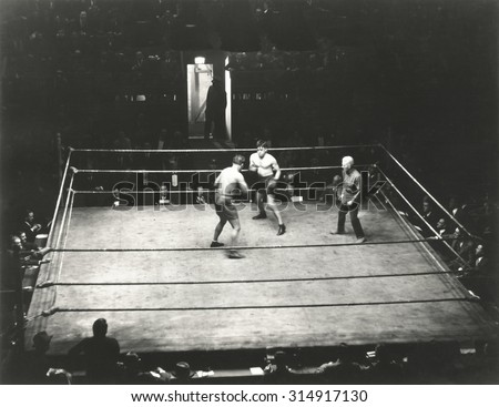 High angle view of boxing match - stock photo