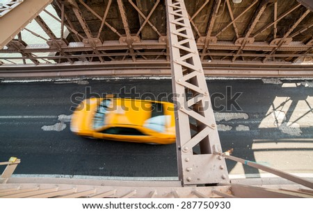 High angle view of car driving over Brooklyn Bridge, Manhattan, New York - stock photo