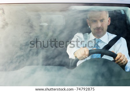 high angle view of caucasian mature business man with hands on steering wheel, looking away. Horizontal shape, waist up, copy space