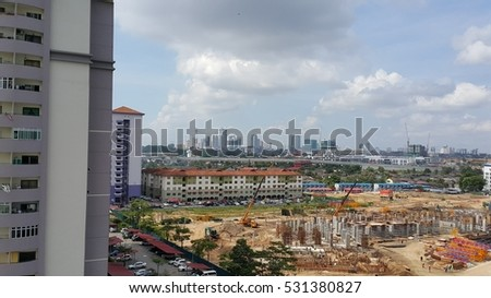 High angle view of cityscape with construction site, high rise buildings, mix urban development over cityscape on clear day