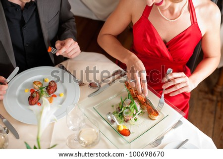 High angle view of couple having food at a restaurant - stock photo
