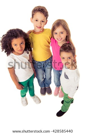 High angle view of cute little kids looking at camera and smiling, isolated on a white background
