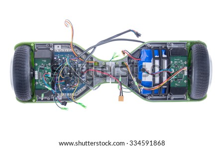 High Angle View of Dual Wheel Self Balancing Electric Skateboard with Exposed Wires and Circuit Boards Isolated on White Studio Background - Taking Apart and Fixing Electronic Skateboard - stock photo