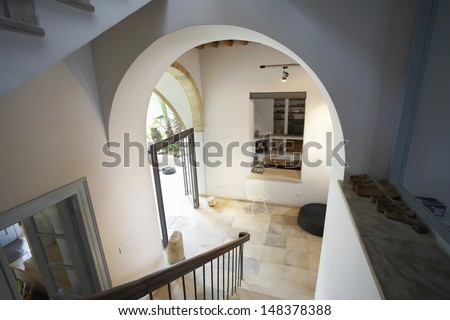 High angle view of hallway staircase in restored antique town house - stock photo