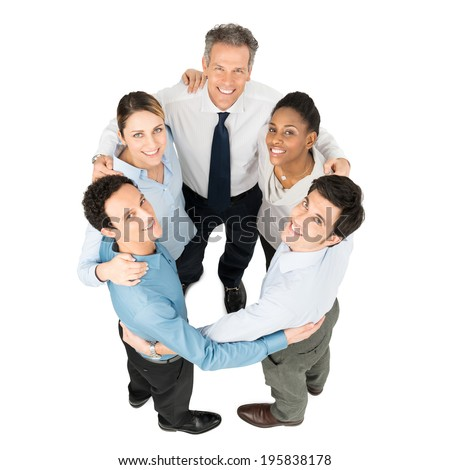 High Angle View Of Happy Businesspeople Making Huddle - stock photo