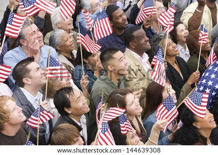 High angle view of happy multi ethnic people holding American flag - stock photo