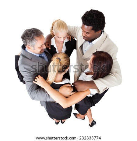 High angle view of multiethnic business people forming huddle over white background - stock photo