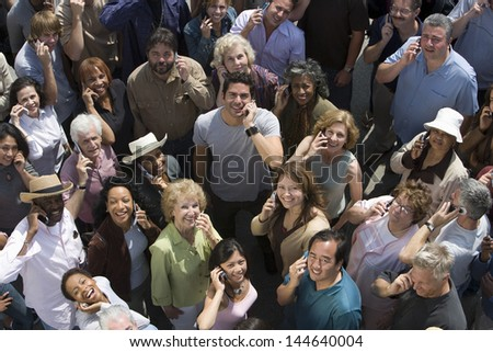 High angle view of multiracial people using cell phones - stock photo