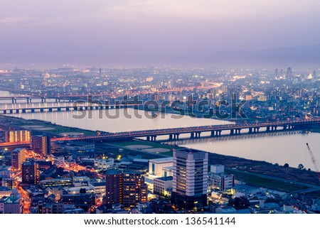 High angle view of Osaka city with Yodo river at sunset time. - stock photo