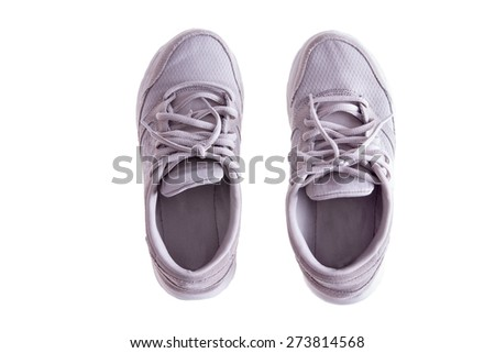 High Angle View of Pair of Worn White Sneakers or Running Shoes with Tied Laces on White Background - stock photo