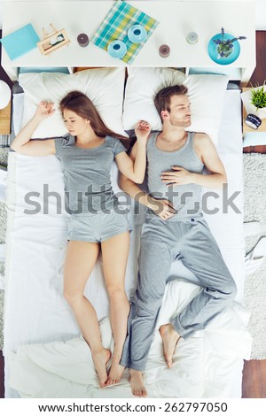 High angle view of people sleeping in bed - stock photo